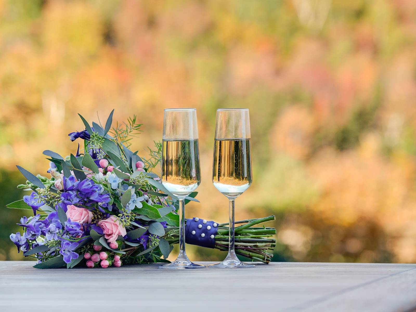 Champagne Flutes with Wedding Bouquet and Mt. Washington in the Background