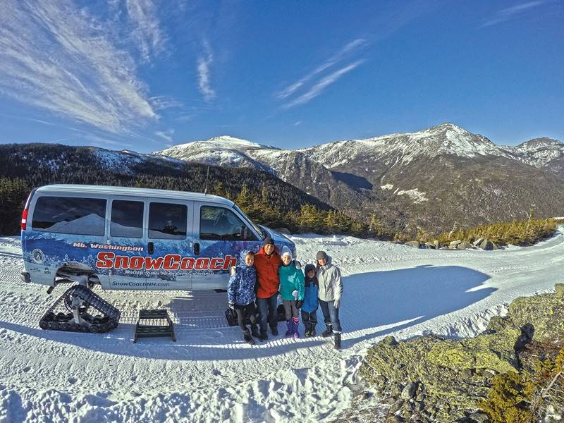 Family in front of SnowCoach with Mt Washington Auto Road