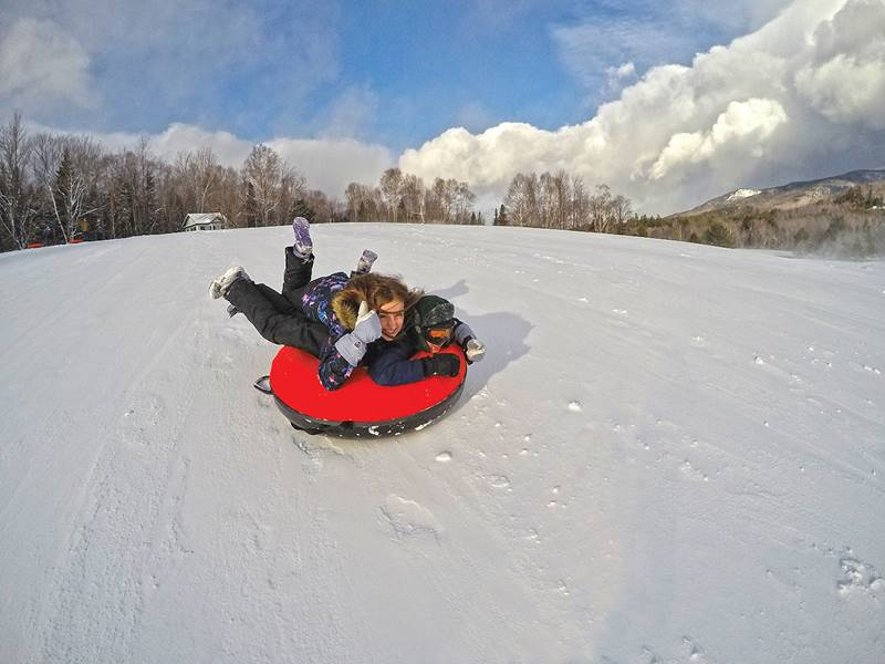 People Snow Tubing at Great Glen Trails